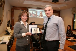 Figure 1: Mr Paschalidis offers the award to Mrs Makrigianni