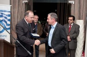Figure: Mr Vamvakas receives the award from the President of the Chamber Mr Diamantaras